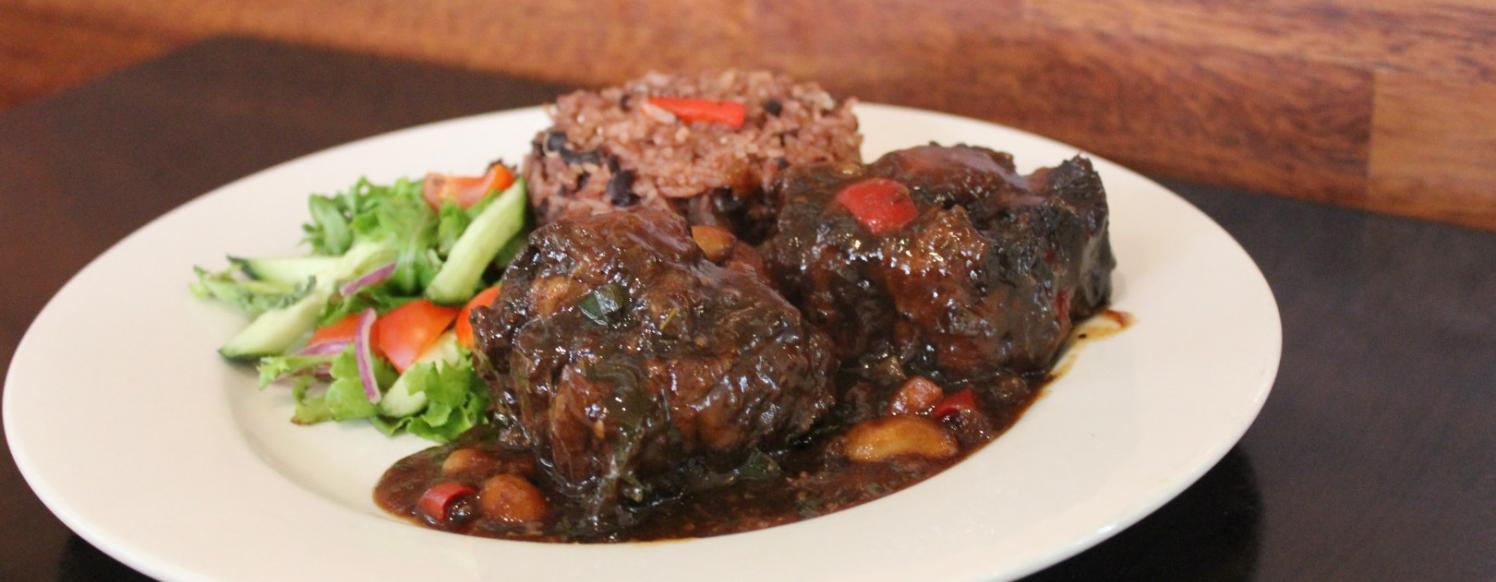 Mama Jamroc Oxtail with broadbeans and rice n peas